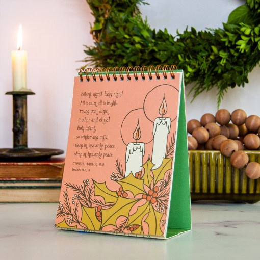 calendar page with Silent Night in pink with illustration of candles